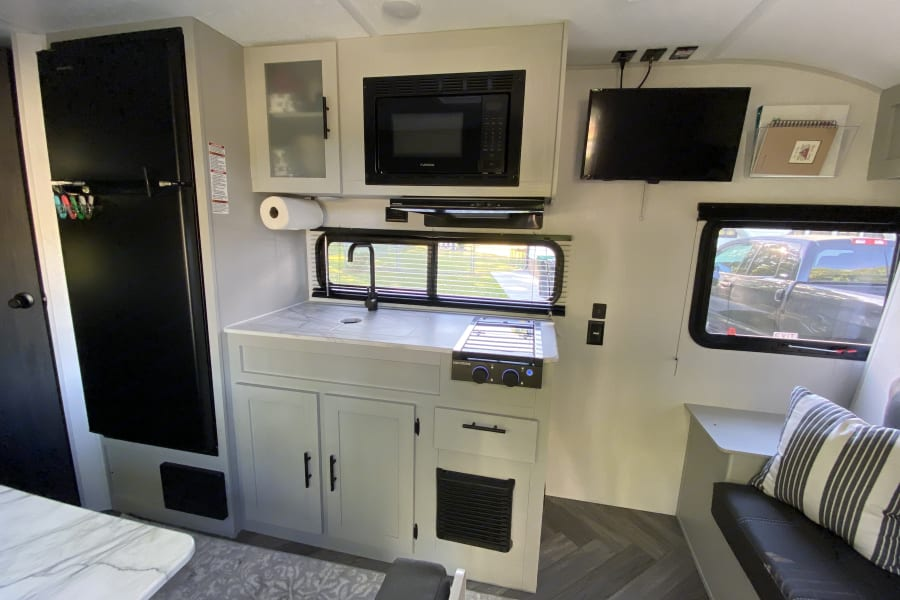 Full view of kitchen that includes cutlery, dishes and much more.