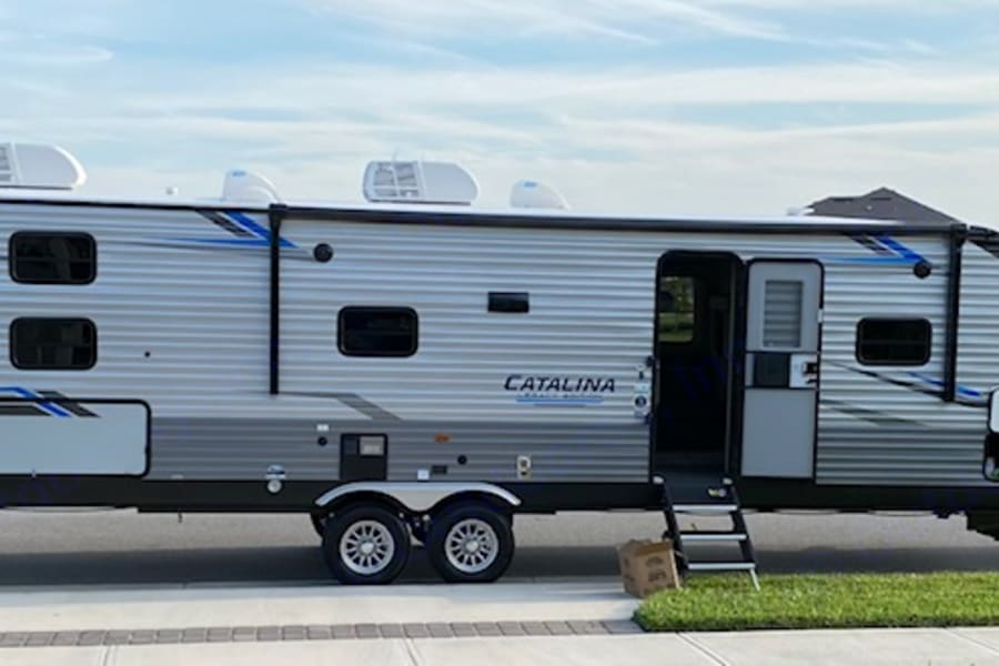 Exterior- passenger side awning and LED lights, steps that allow for any leveling situation