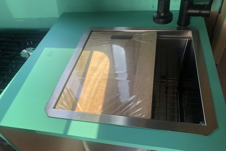 Deep sink with chopping board on the top
