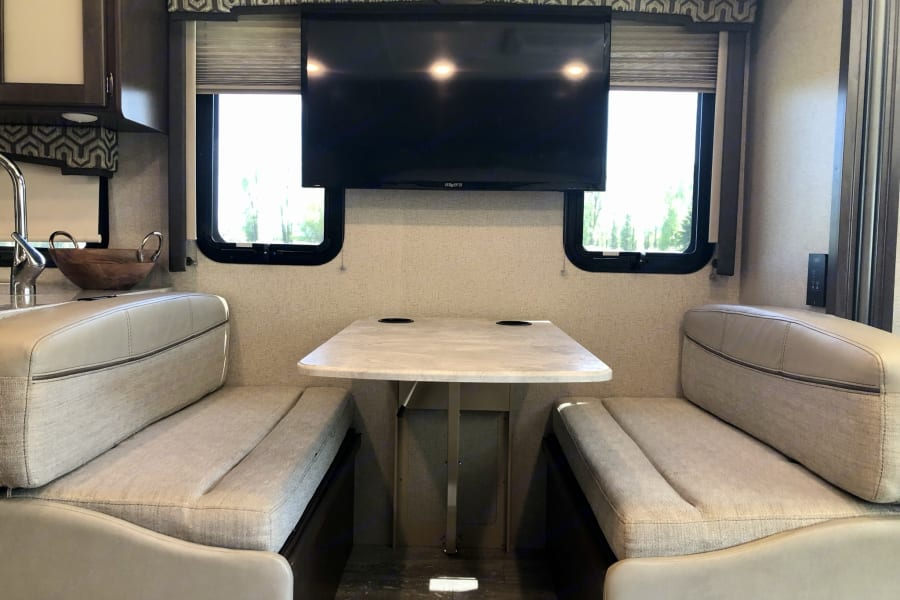 """Dinette with 40"""" LED TV in the living area"""