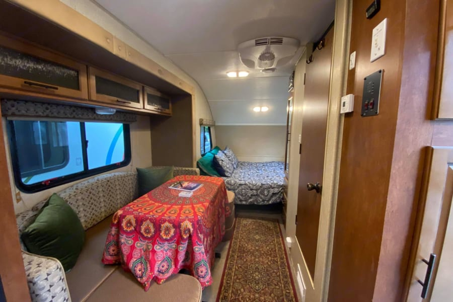 The dinette area slides out for additional room inside the camper