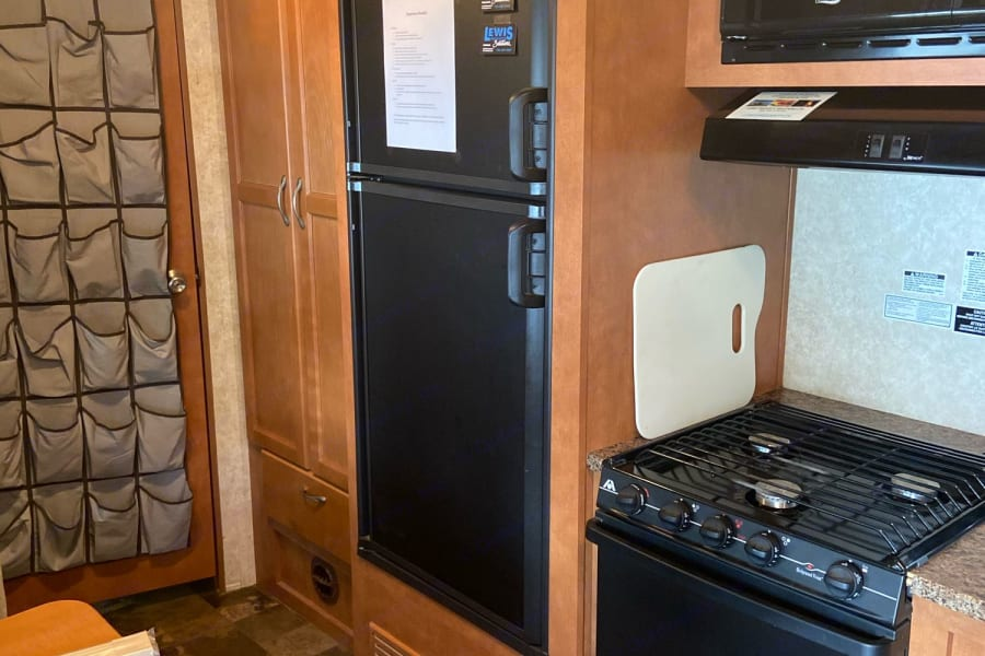 Kitchen includes plenty of storage, pantry and stove/oven combo