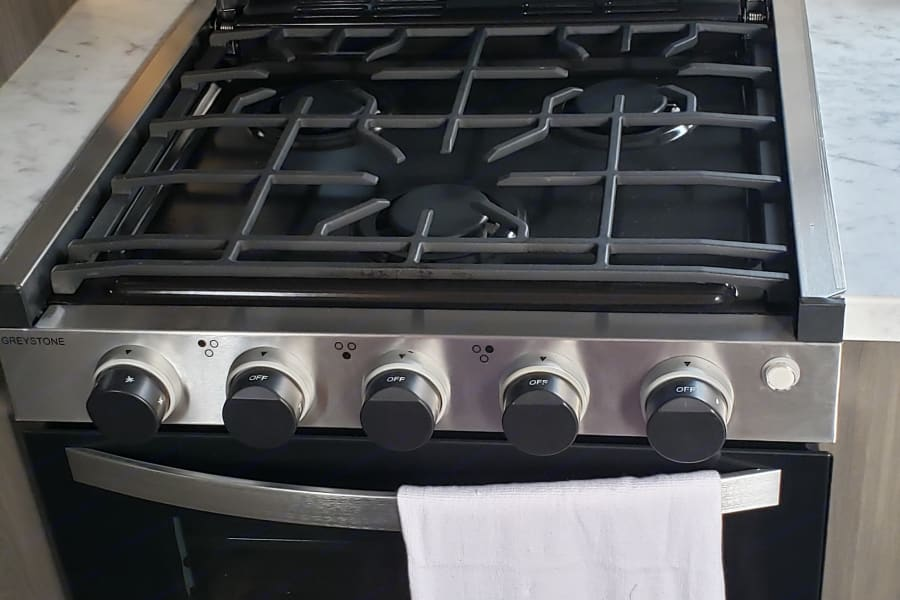Gas stove and oven, electric microwave.