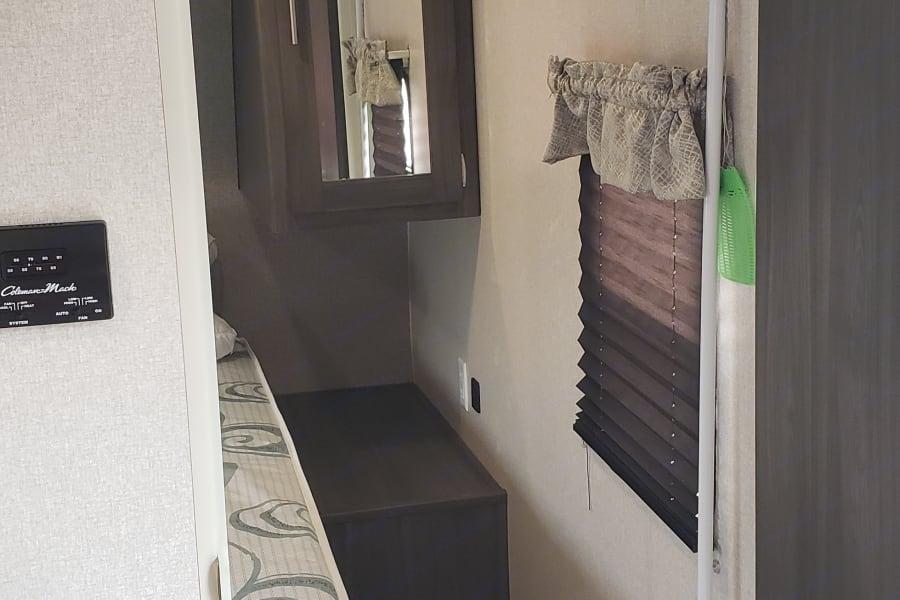 Looking into bedroom from bedroom door.