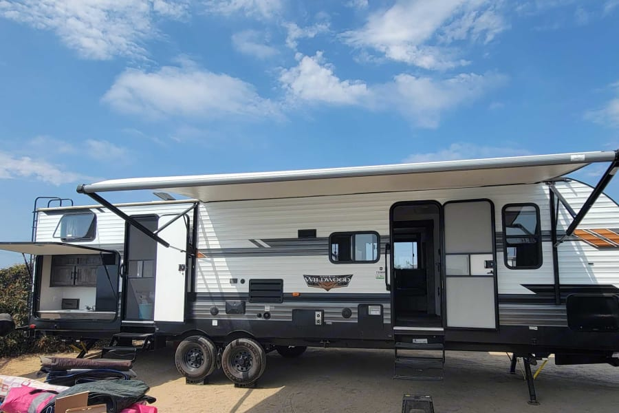 36 ft. trailer with 2 doors, outdoor kitchen, speakers play inside/outside or both.  Awning with lighting, outdoor wash station.