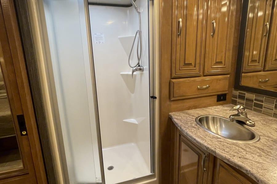 Tall shower that fits people of any size.