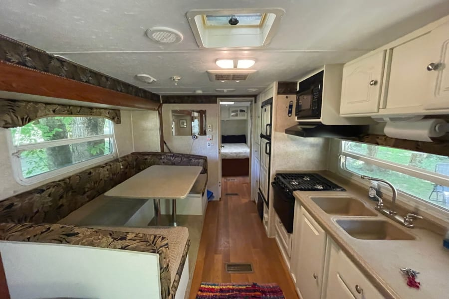 Fully Stocked Kitchen and convertible sleeper dinette. Cook great meals and room for a crowd!