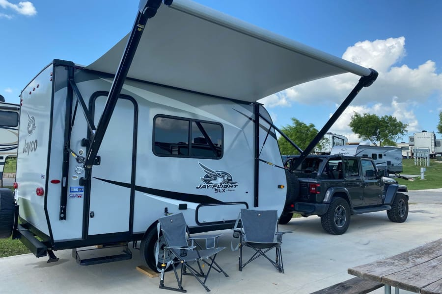 Relax and unwind under the 10' power awning equipped with LED lights and speakers!