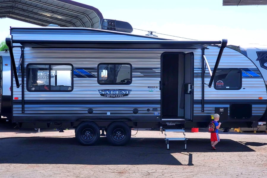 Here's a side view of this gorgeous modern trailer. Don't mind the photo bombing toddler.