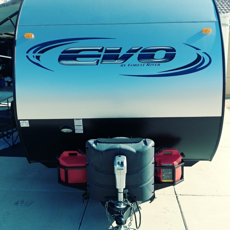 """Front houses 10 gallons of propane and custom mounts for CA legal gas cans for rent, all supported by an electric tongue jack. 2 5/16"""" ball needed"""