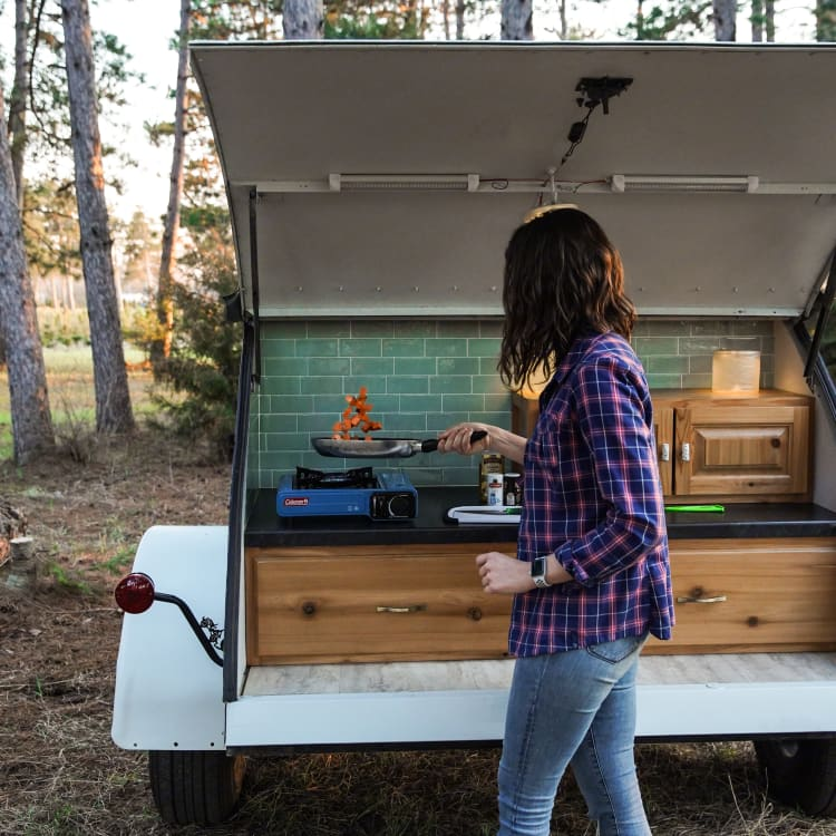 The back hatch keeps you sheltered from the sun and rain while using the kitchen