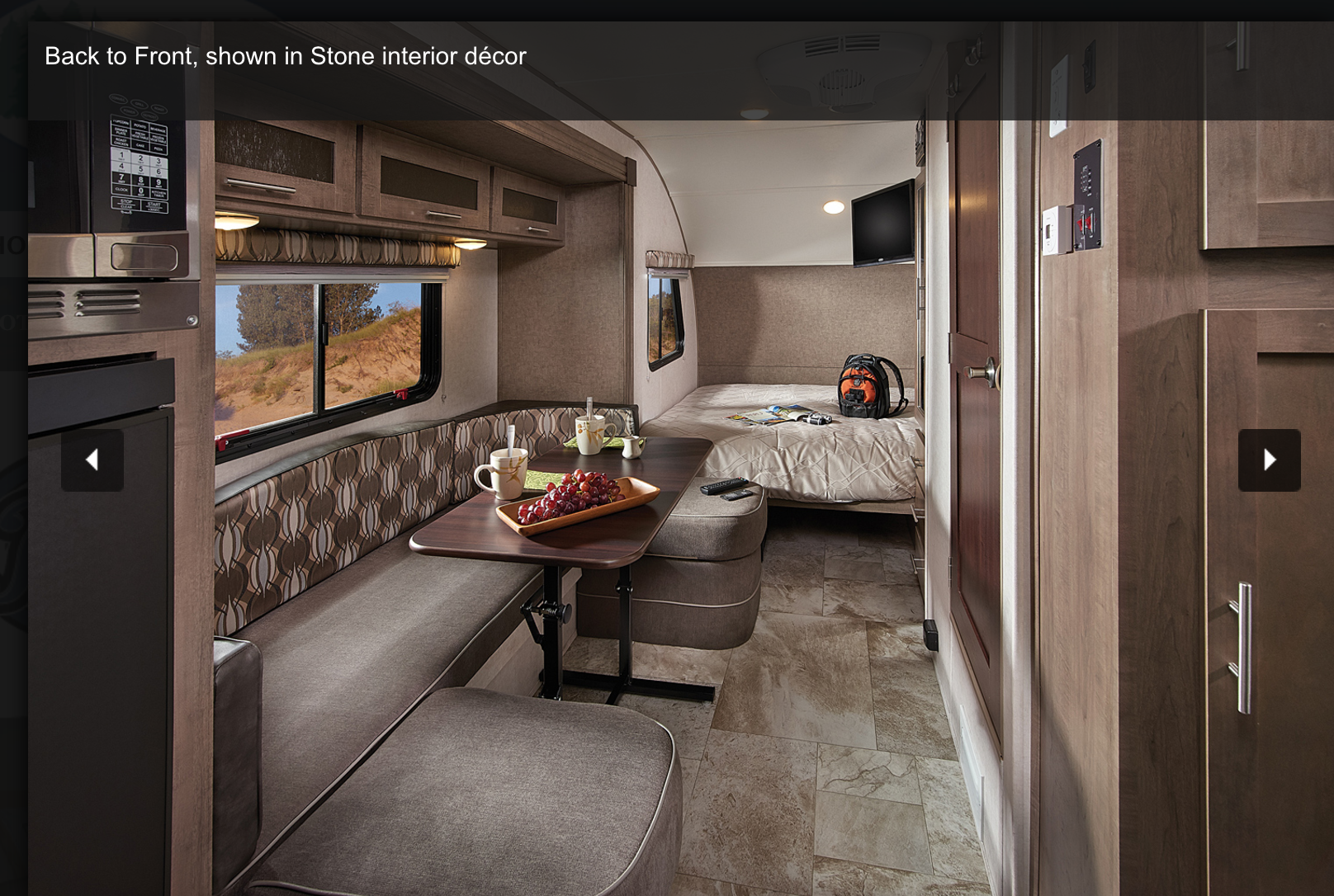 Dinette that turns into a bed for 2, plus queen size mattress towards the front. -Stock brochure picture for perspective