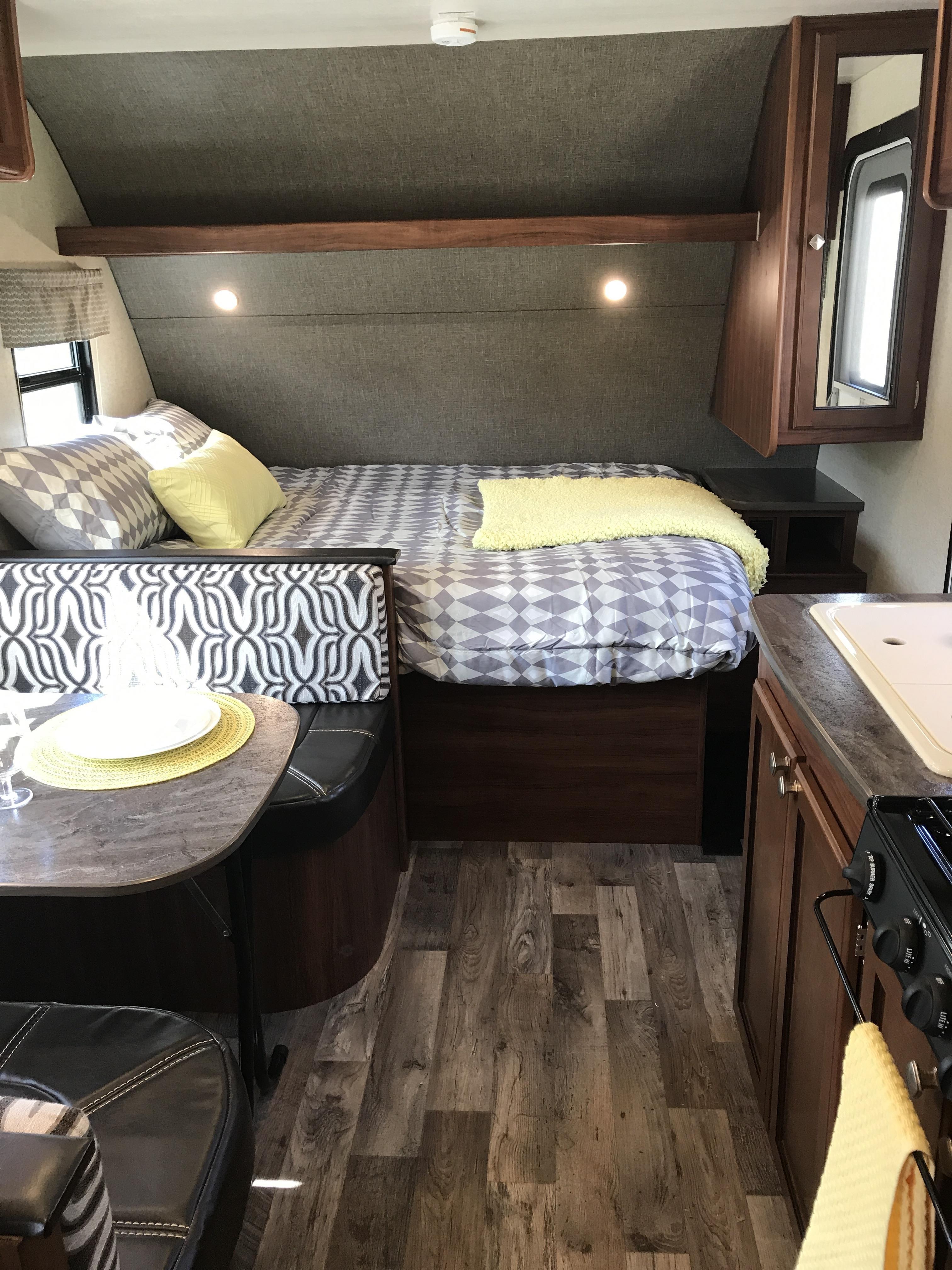Queen bed in front with side wardrobe. Heartland Mallard 2018