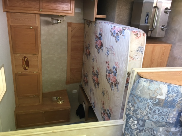Master bedroom with storage underneath bed and in cabinets. Closing accordian door.. Crossroads Zinger 2006