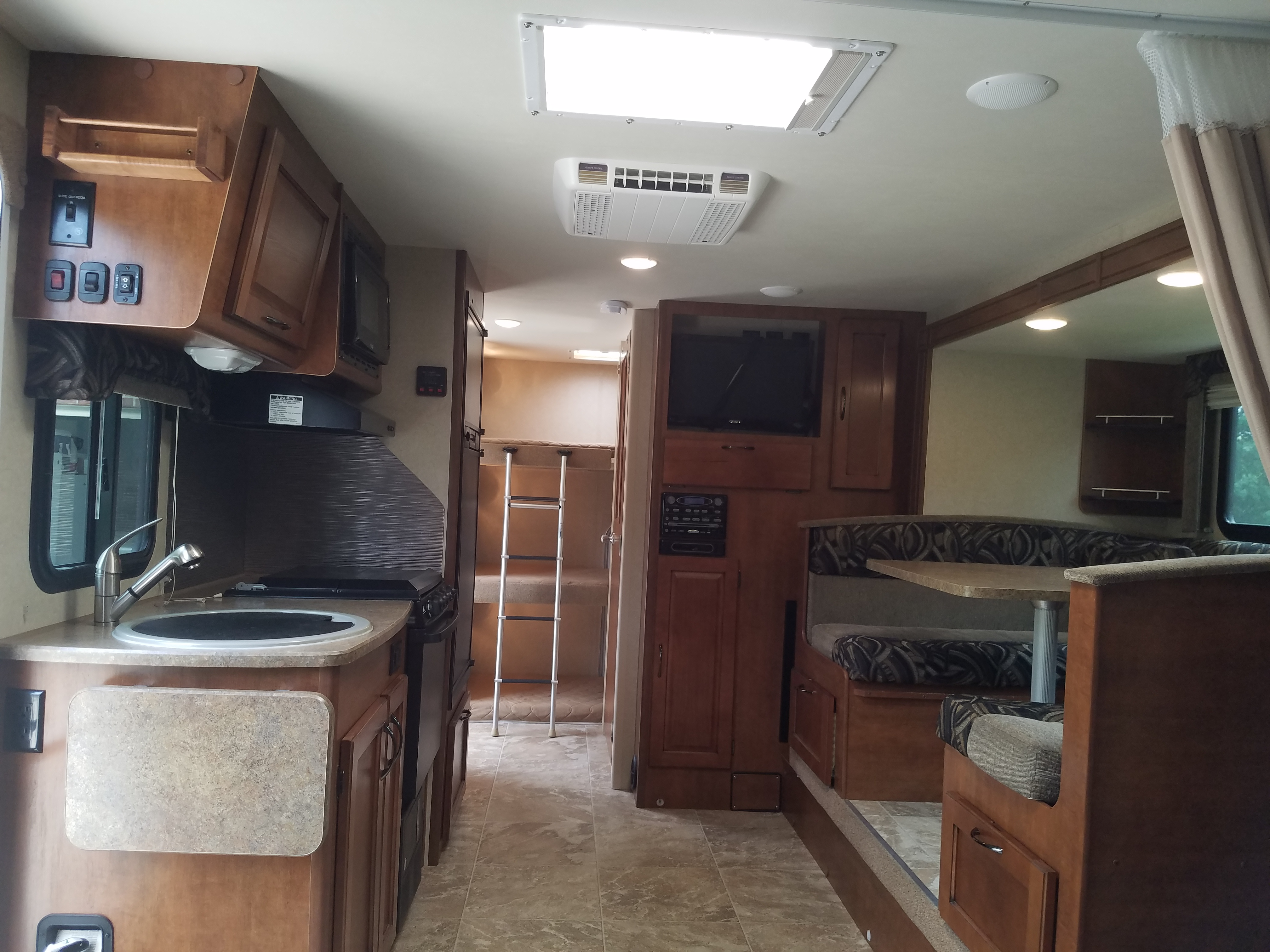 Roomy interior with the Super-slide out.  This is a stock photo but very close to the real deal.  Lance has built a high-end camper with low-VOC eco-finishes and mold-resistant materials that do not bother even the more sensitive of us.. Lance 2185 2015