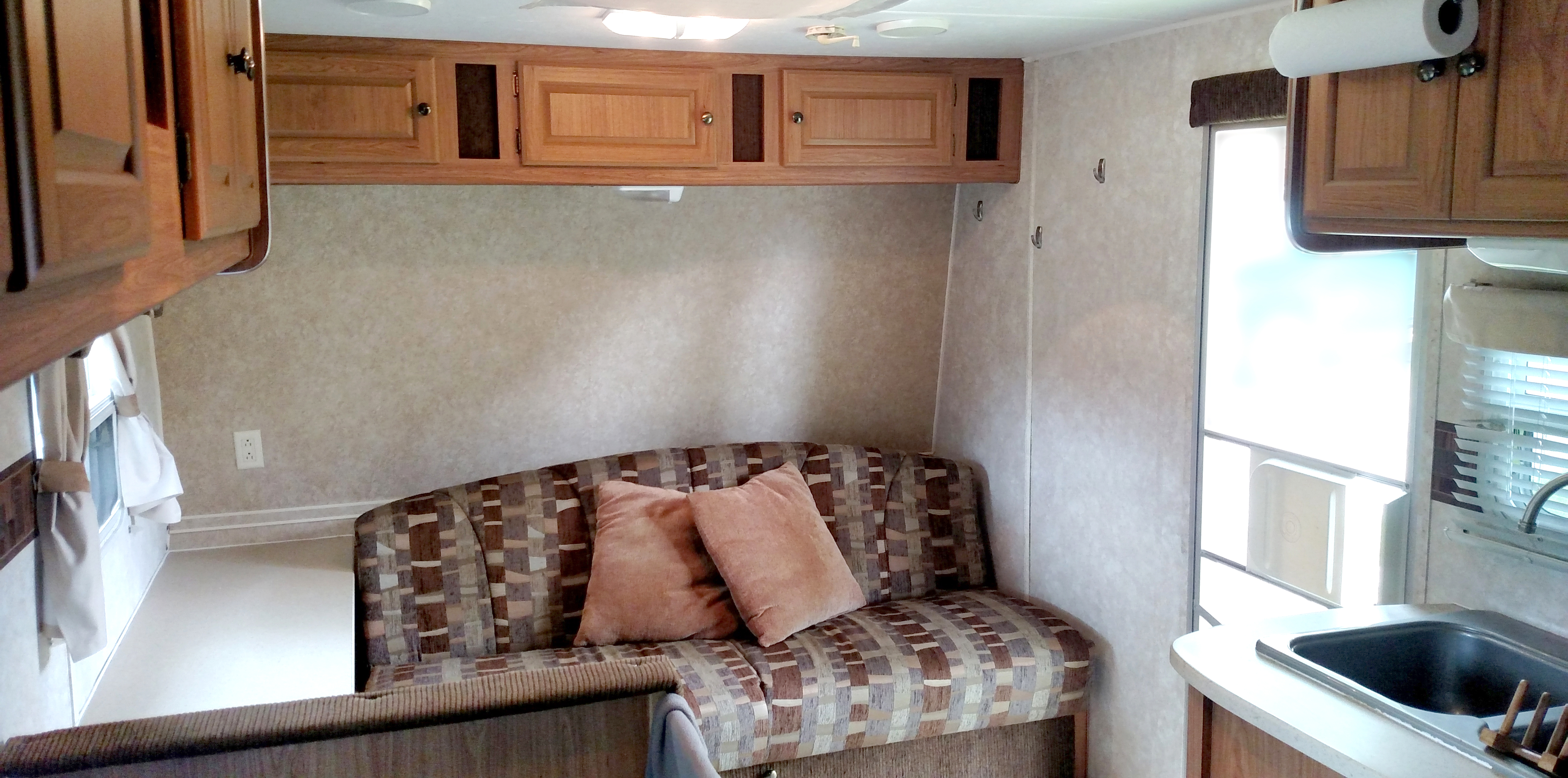 Comfortable couch that folds down into a full-size bed. Storage above and below.. Forest River Wildcat 2008