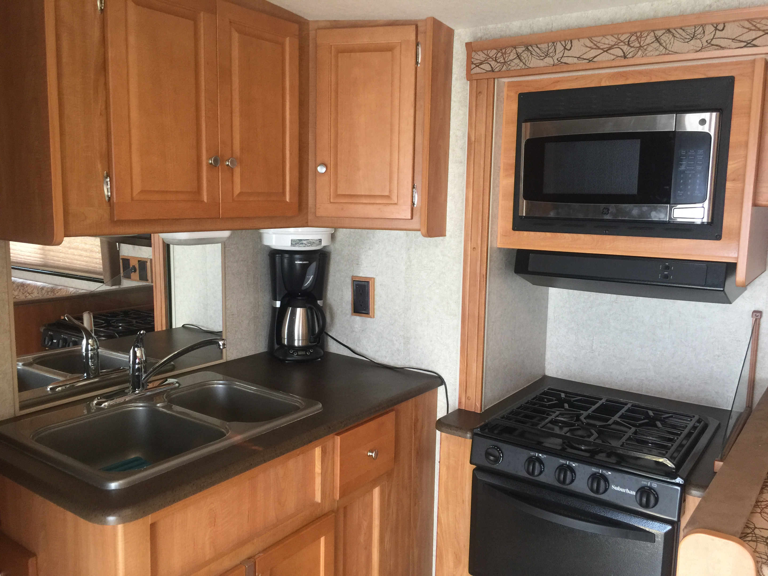 Kitchen area has dual sink, microwave, oven, stove, coffee maker, toaster and more. Fridge and separate freezer have more space than most RVs offer. Like having ice cream and kids like popsicles? Buy them both! There's room!. Winnebago Vista 2008