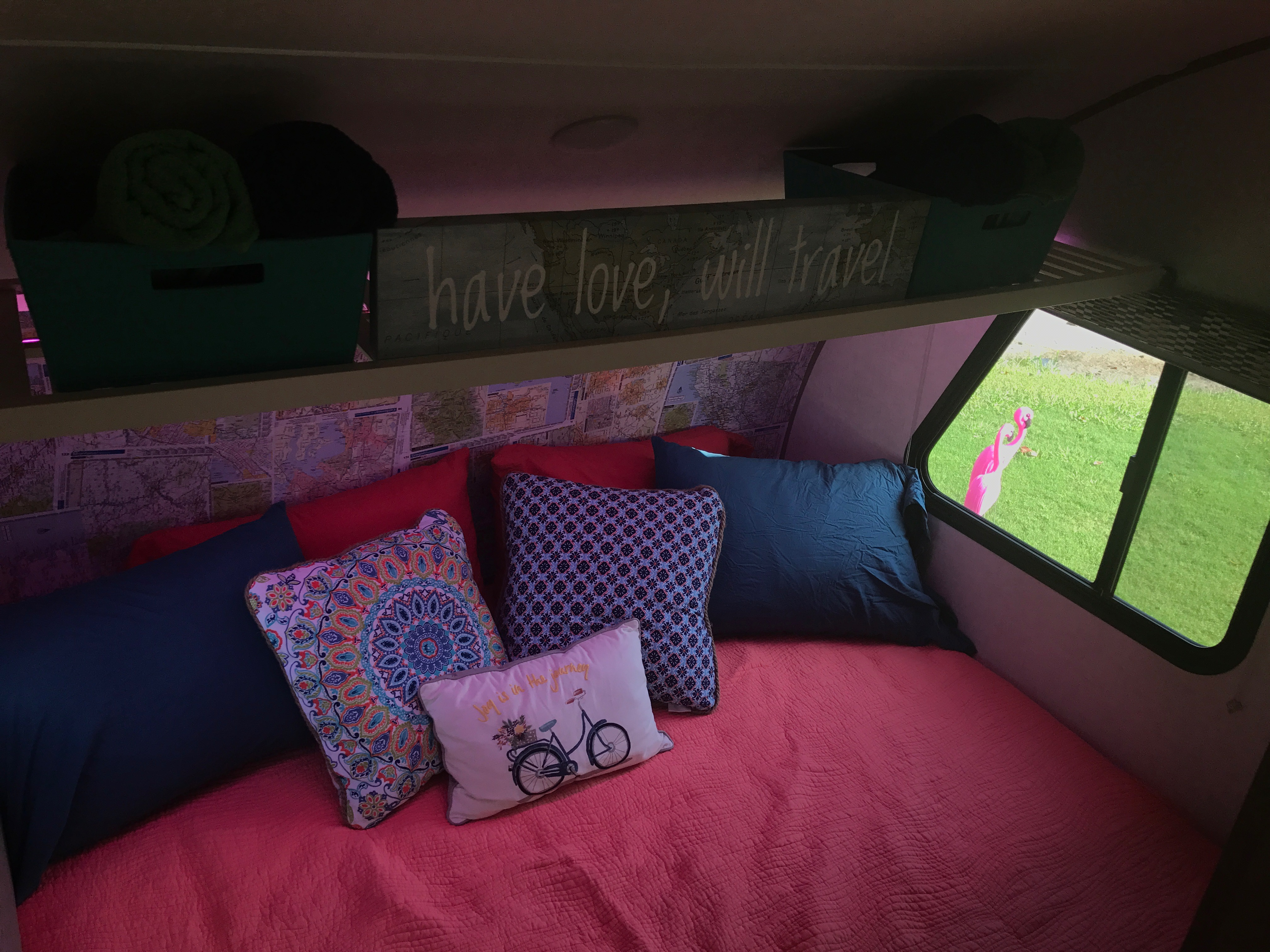 Cozy Queen bed to greet you after your daytime adventures. -Actual travel trailer setup!