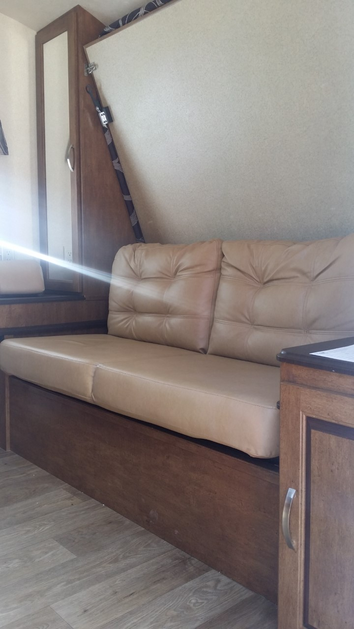 Enter into living room couch, with Murphy bed above.. Forest River Salem Cruise Lite 2018