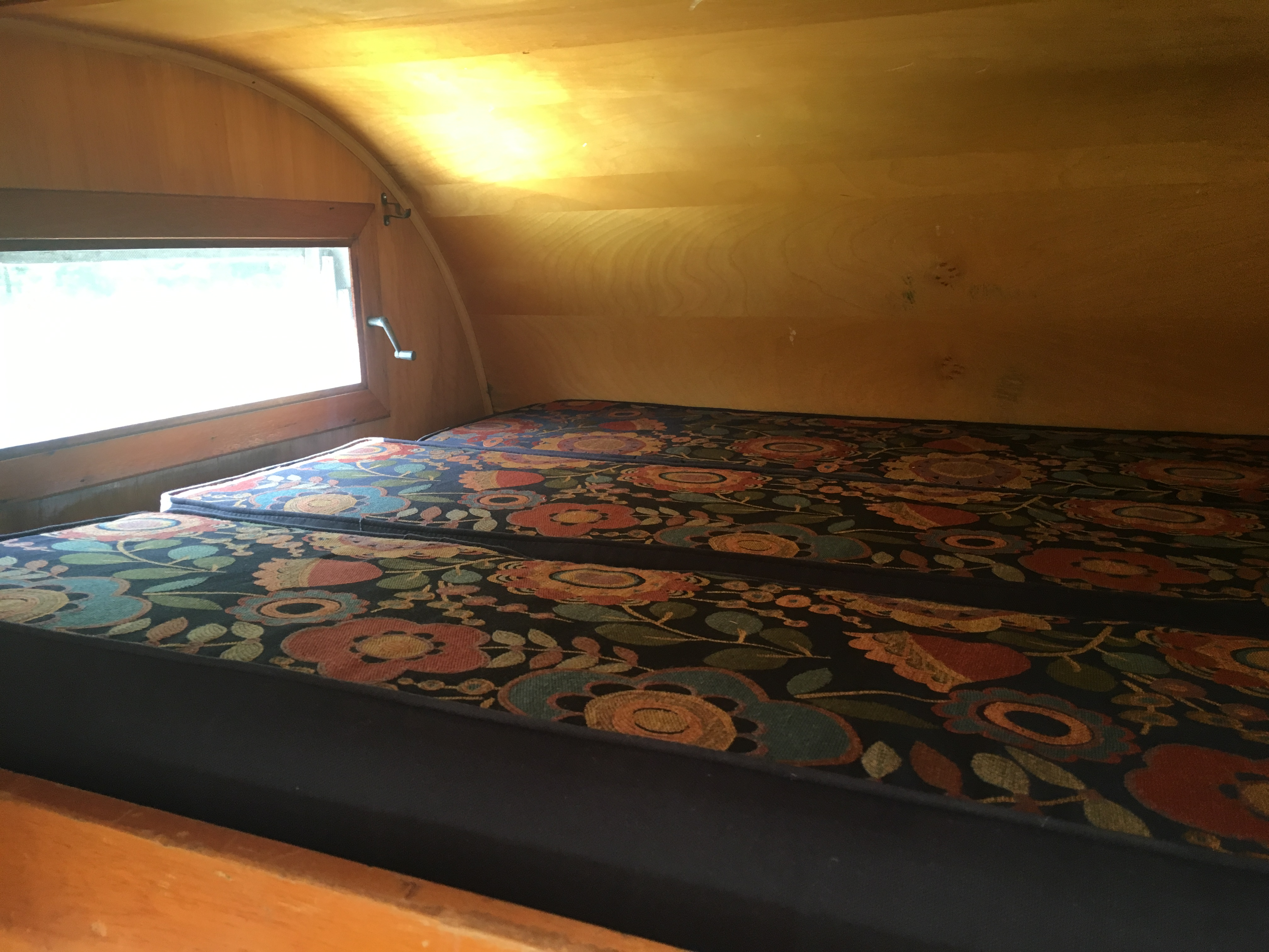 Main bed, double, fits two. There is another small loft bed that can handle weight of one 50 lb child. . Frolic classic 1964