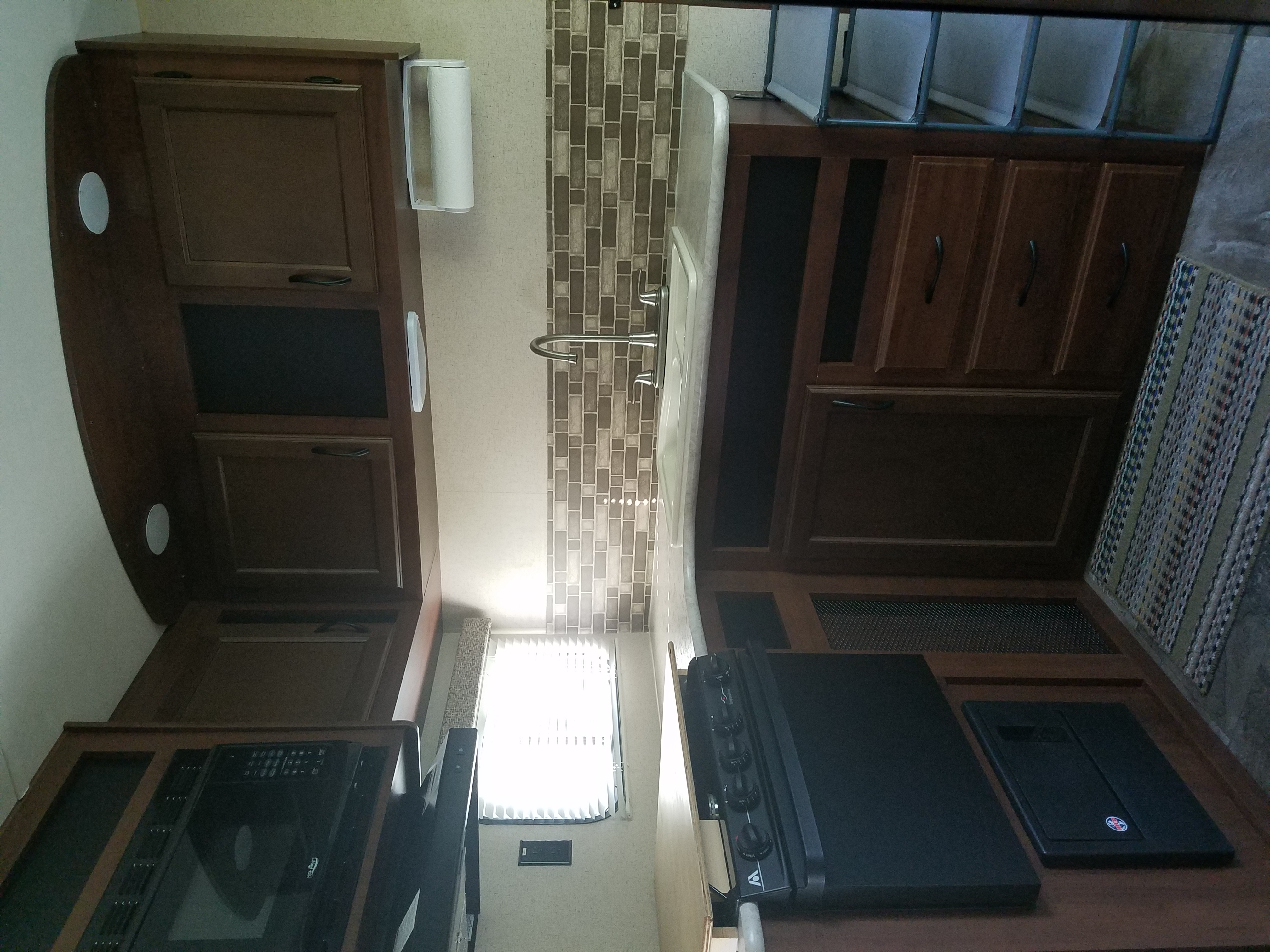 Kitchen is L shaped with Microwave, Oven and Stove.  Stove topper handmade allows extra counter space.. Jayco Jay Flight 2015