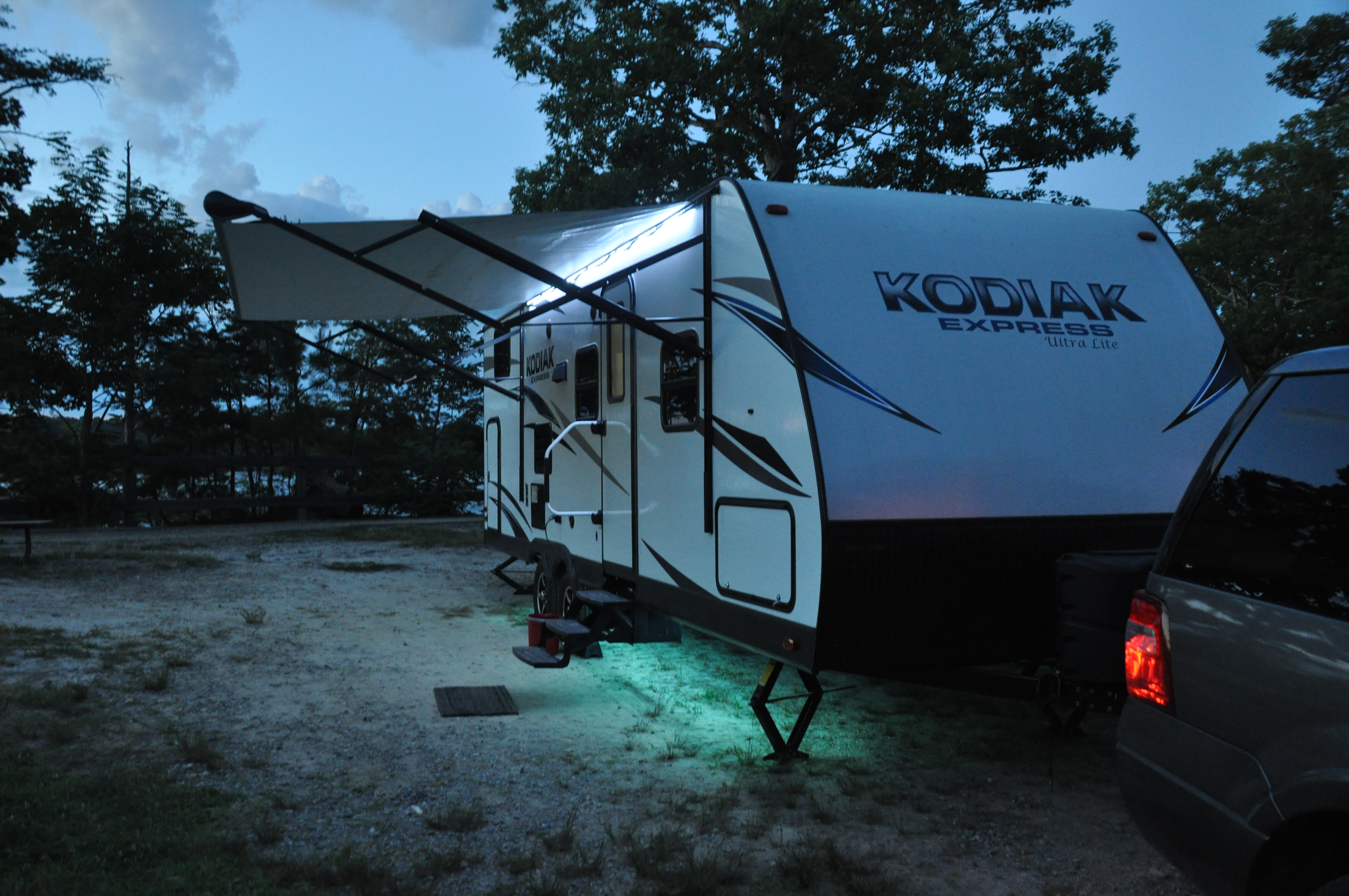Night time patio lights under awning. Dutchmen Kodiak 2017