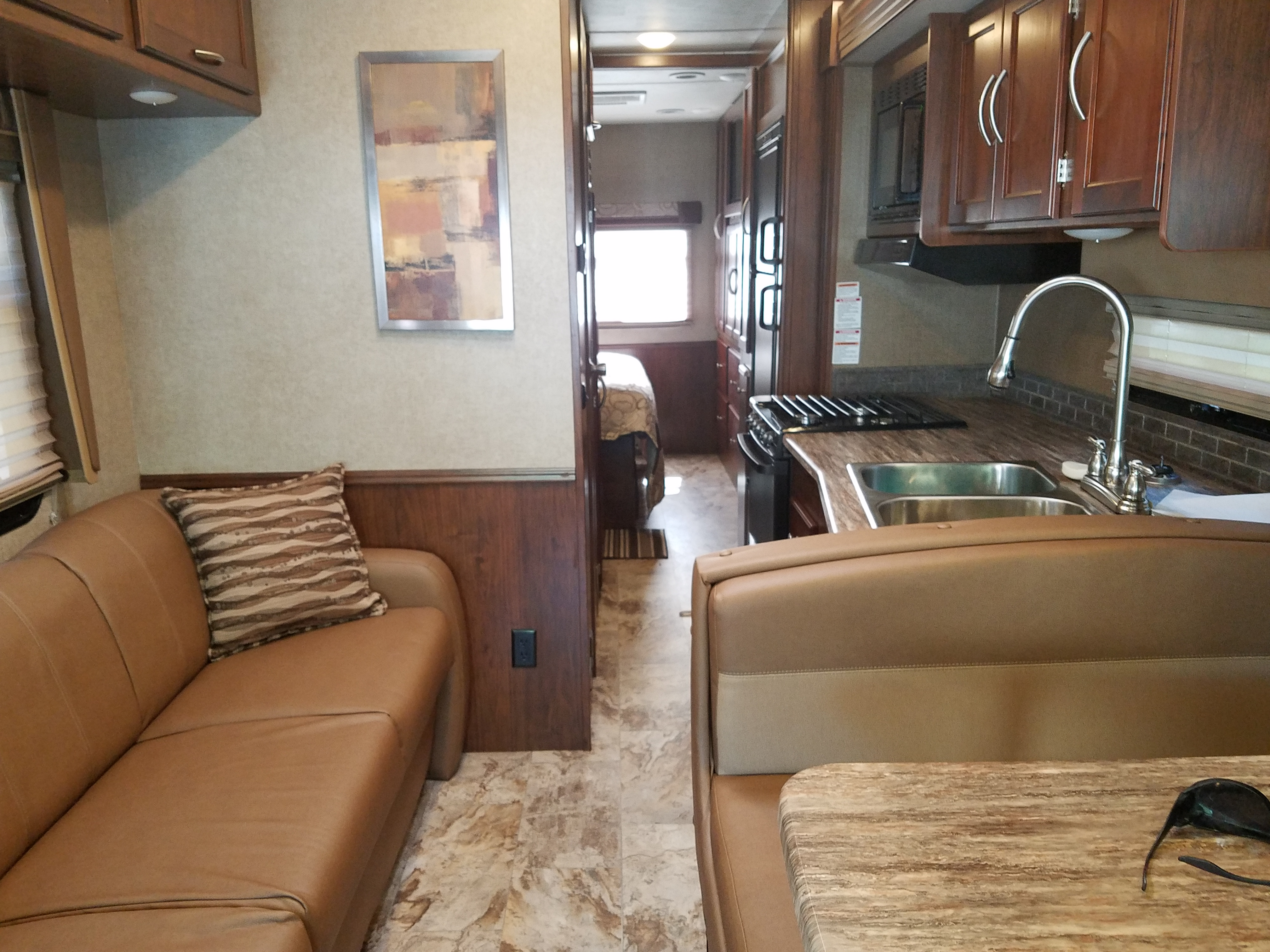 Wide coach, plently of room even when slides are in.stainless steel double sink. Easy to use Microwave oven.. Coachmen Pursuit 2017