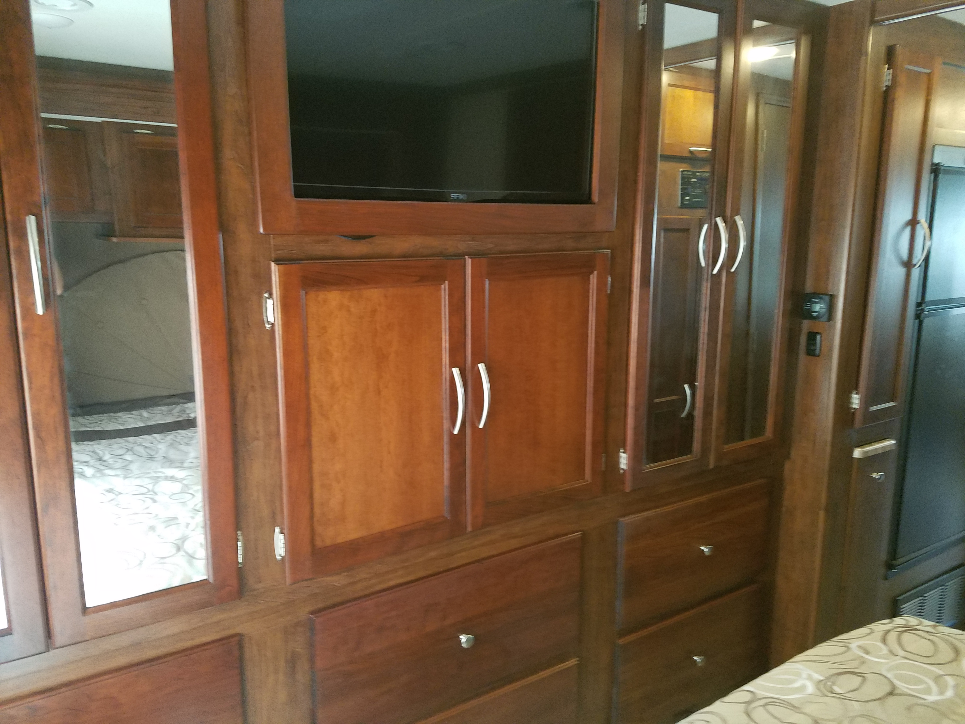 """This is the bedroom TV, we have three more on 50"""", and a 42"""" outside. Lots of storage. . Coachmen Pursuit 2017"""