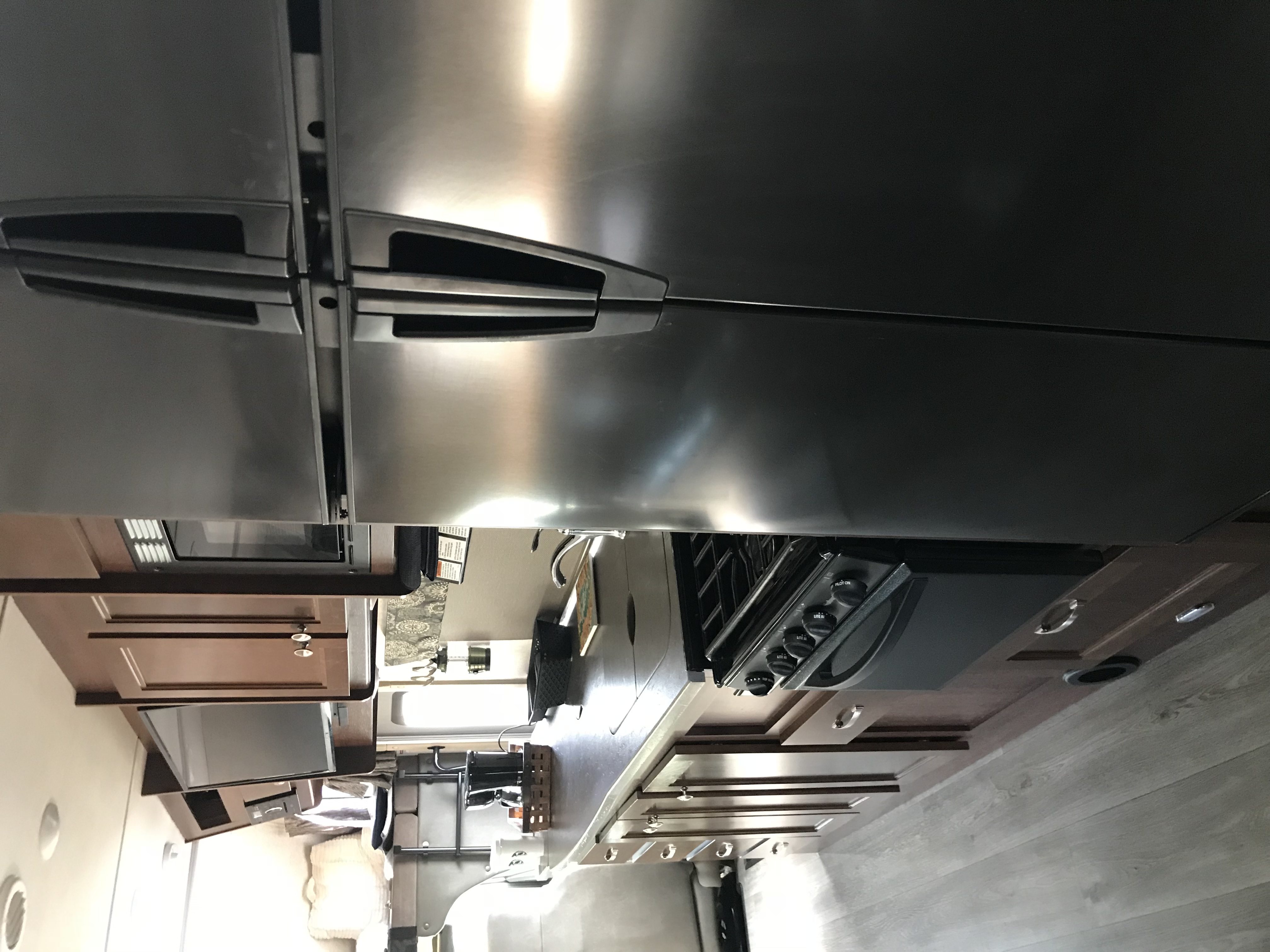 We simply loved this enormous refrigerator. It's wonderful because you can use this propane refrigerator when Boondocking. So you can be off grid for days without being plugged in!. Forest River Sunseeker 2018