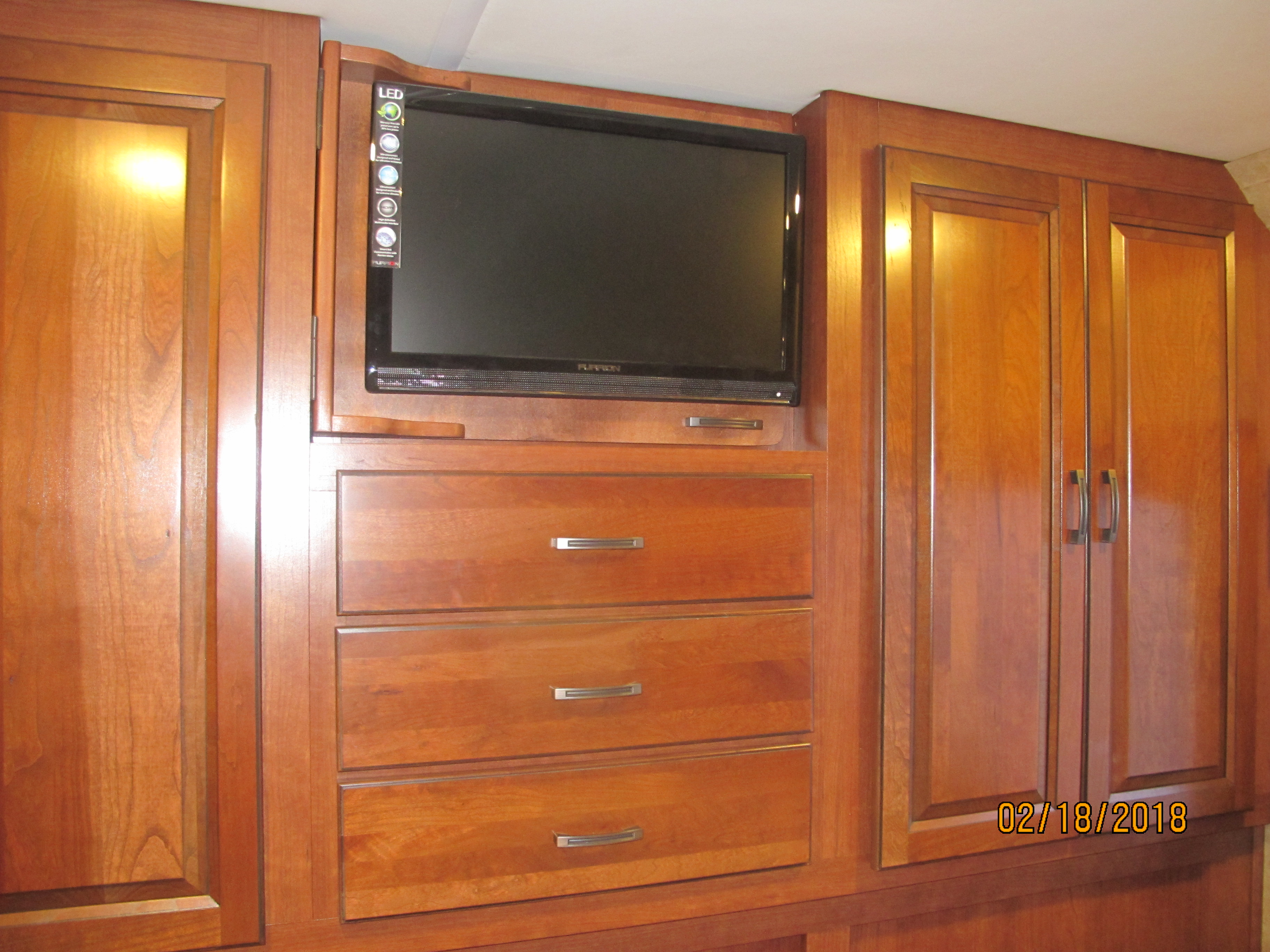 bedroom storage and tv . Forest River Forester 2015