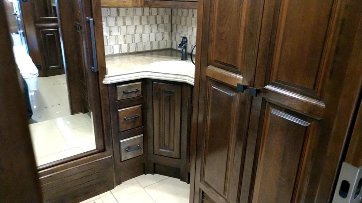 Master bath sink, washer and dryer, and sliding mirrored door closet door