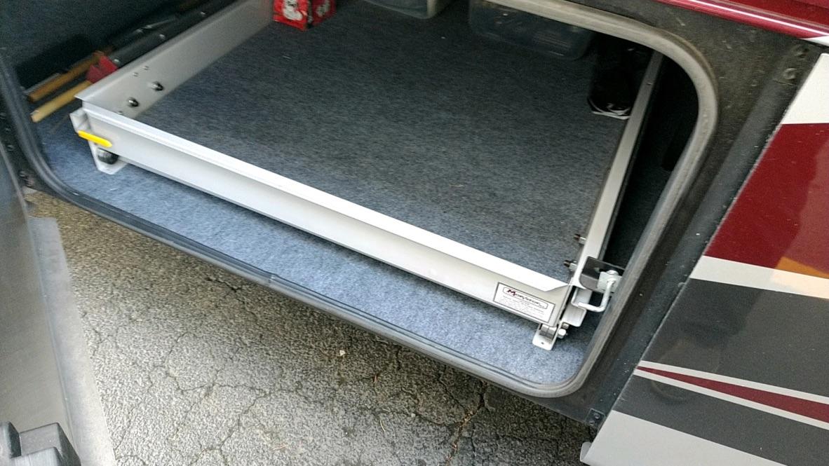 Basement slide out tray
