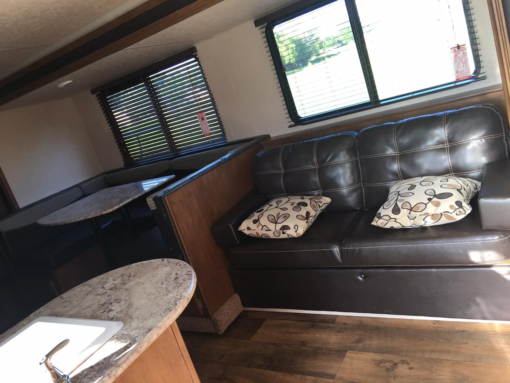 U-shaped dinette - storage under benches  Loveseat / storage behind  Both convert to beds . Forest River Salem Cruise Lite 2018