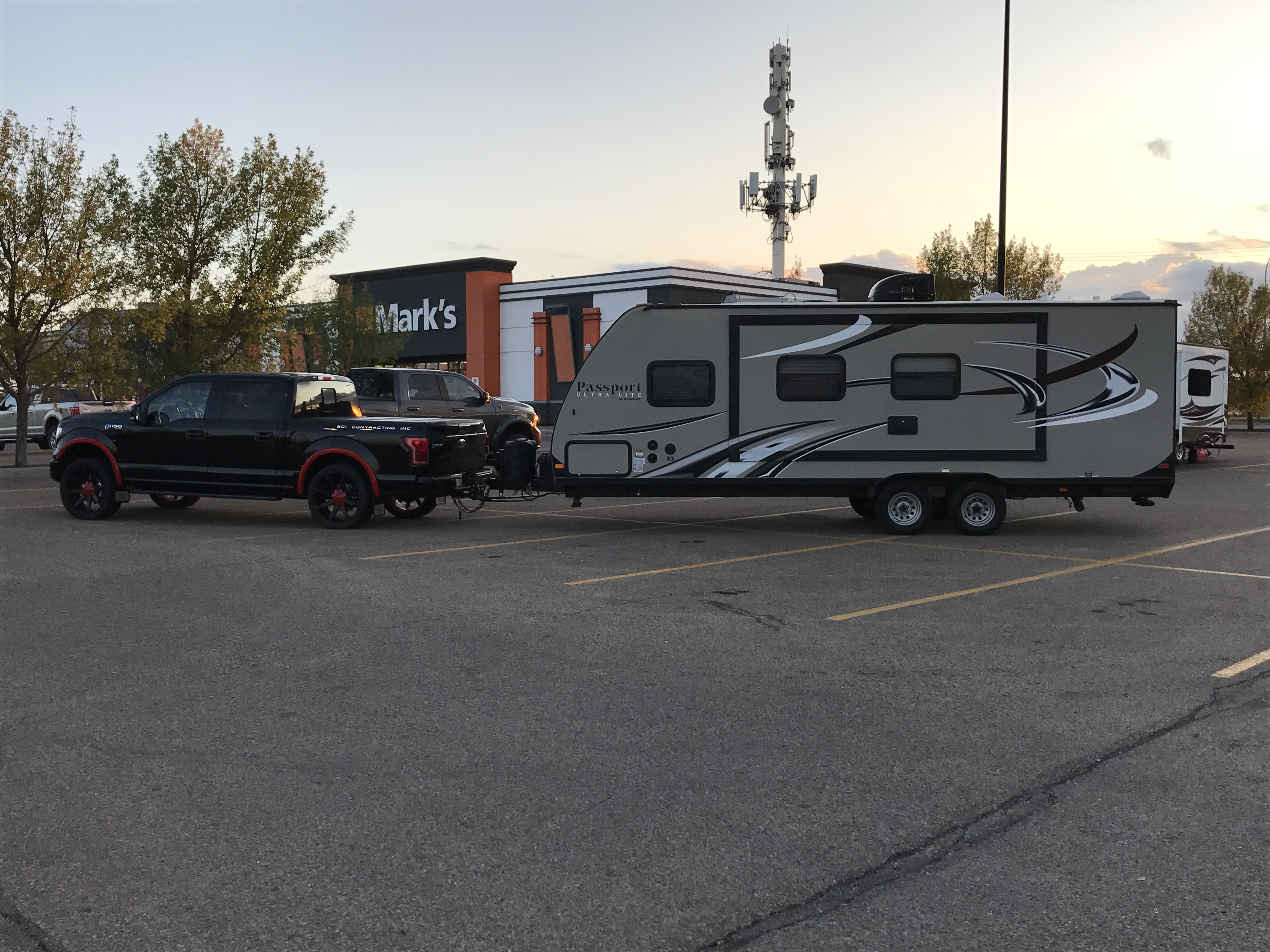 Our first photo before hitting the road on our first venture. Pulled with our 1/2 ton. Equalization bars even the load nicely.. Keystone Passport 2015