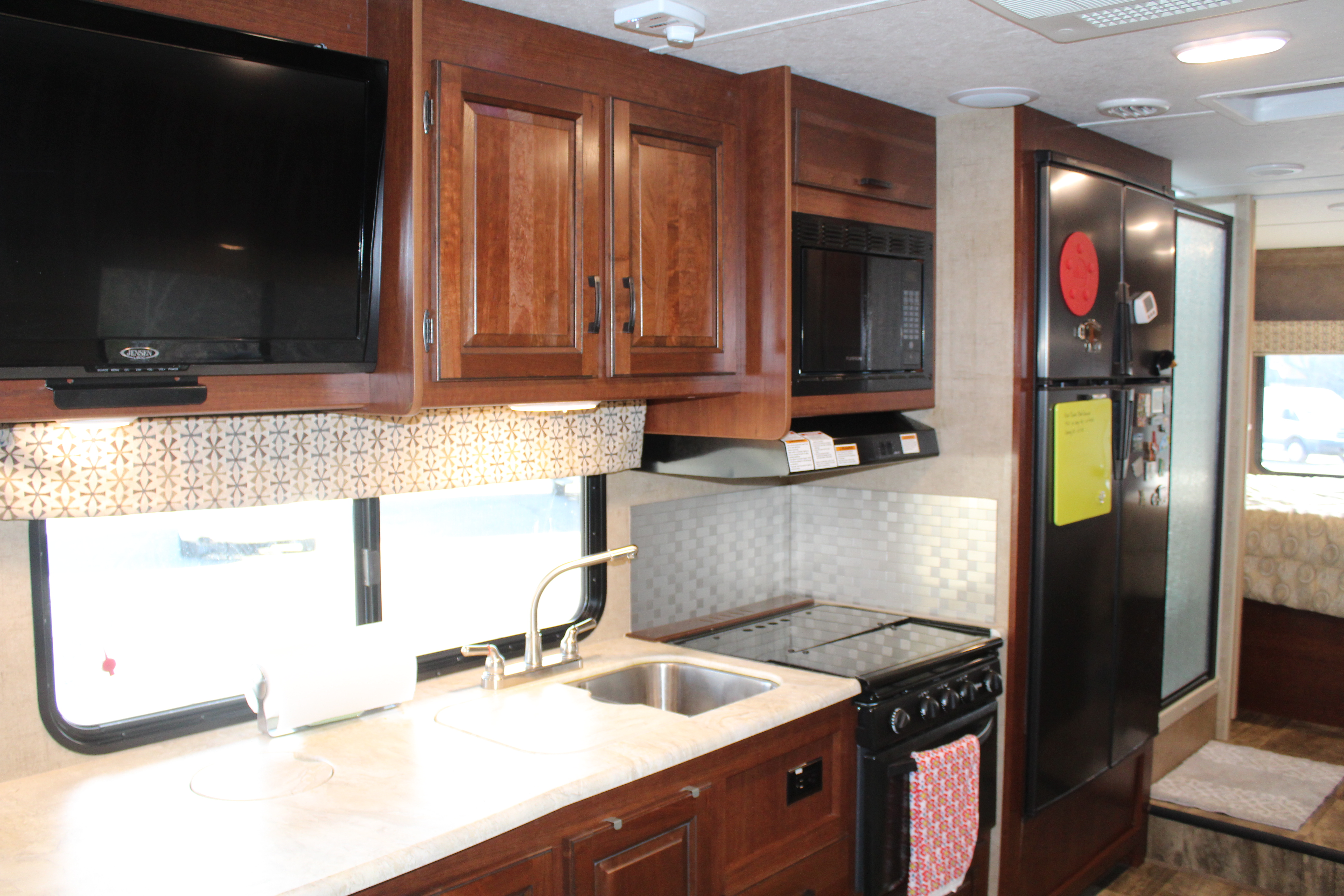 3 burner gas range with hood, microwave, and gas oven.  TV with DVD player and surround sound.. Forest River Sunseeker 2017