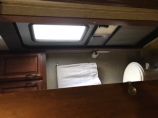 Half bath with access to outside. Palomino Sabre 2014