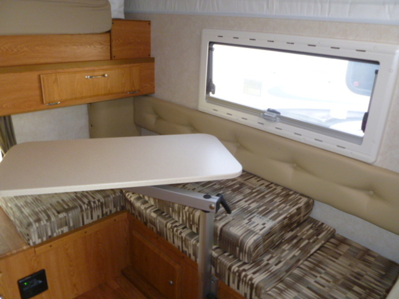 Dinette with Swing Away table easily converts to twin bed/lounger.  Cozy!