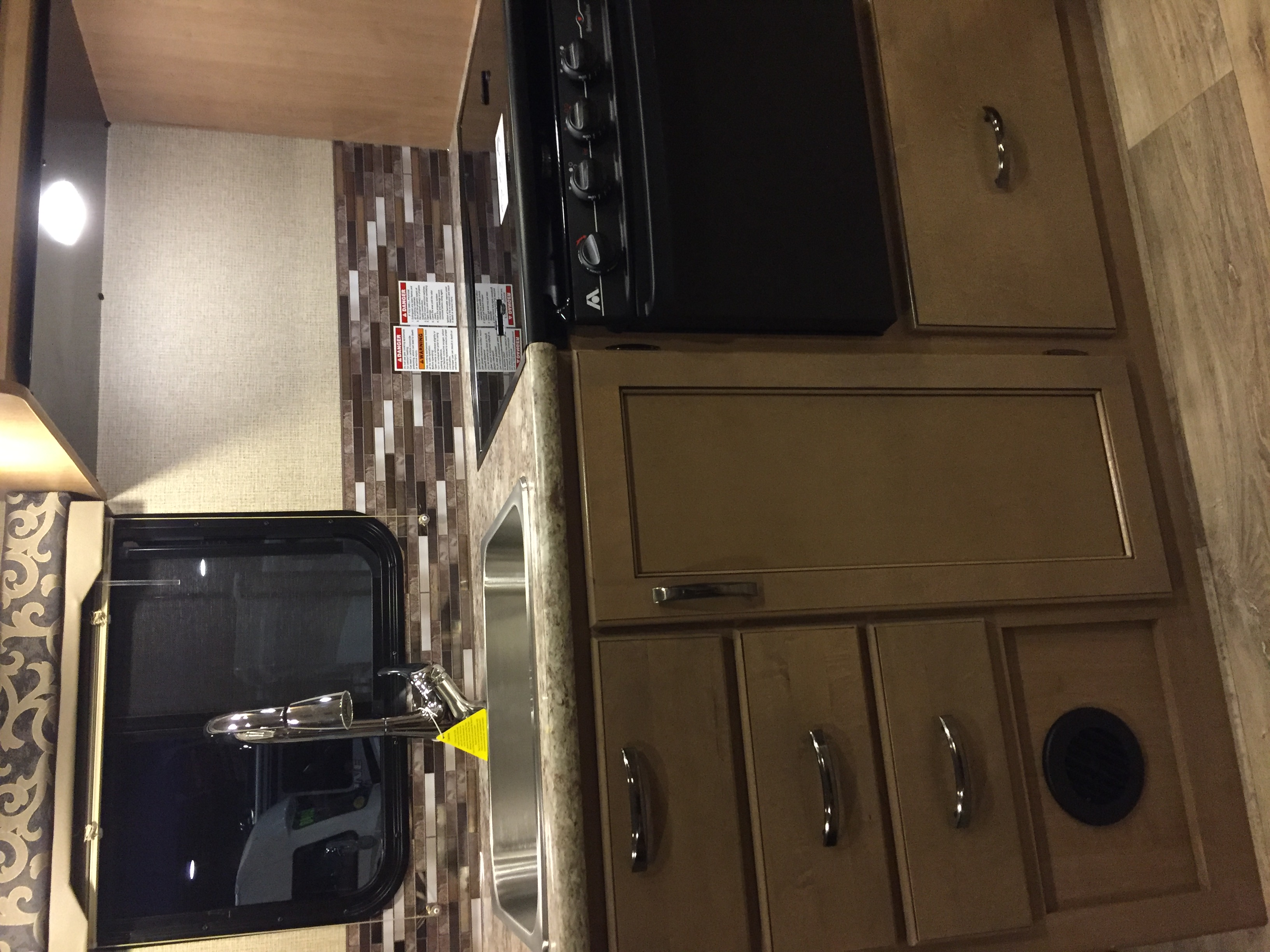Kitchen with full size sink and 3 burner stove, oven and microwave