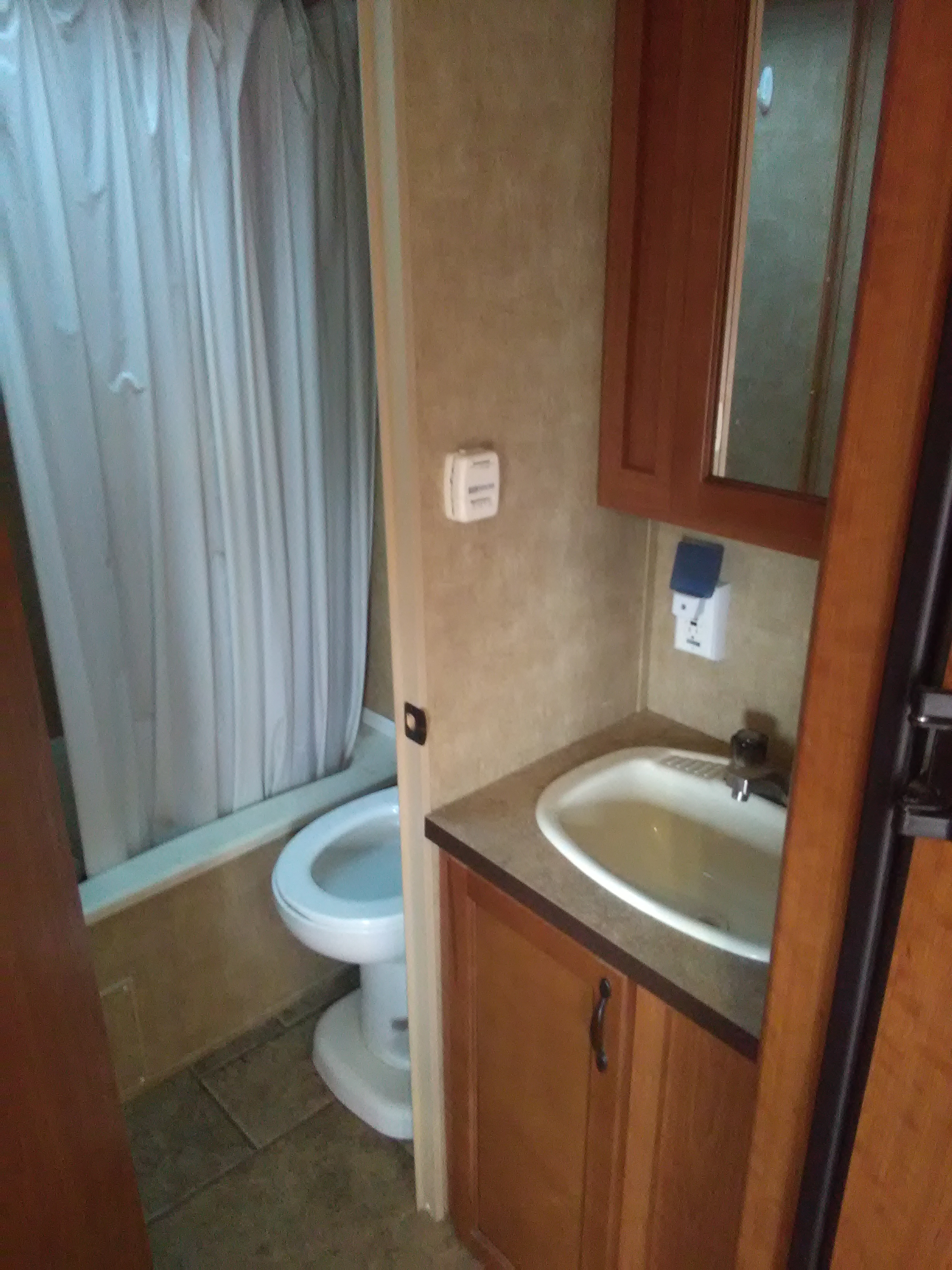 Sink, shower, toilet. Thermostat for propane furnace.. Forest River Cherokee 2011