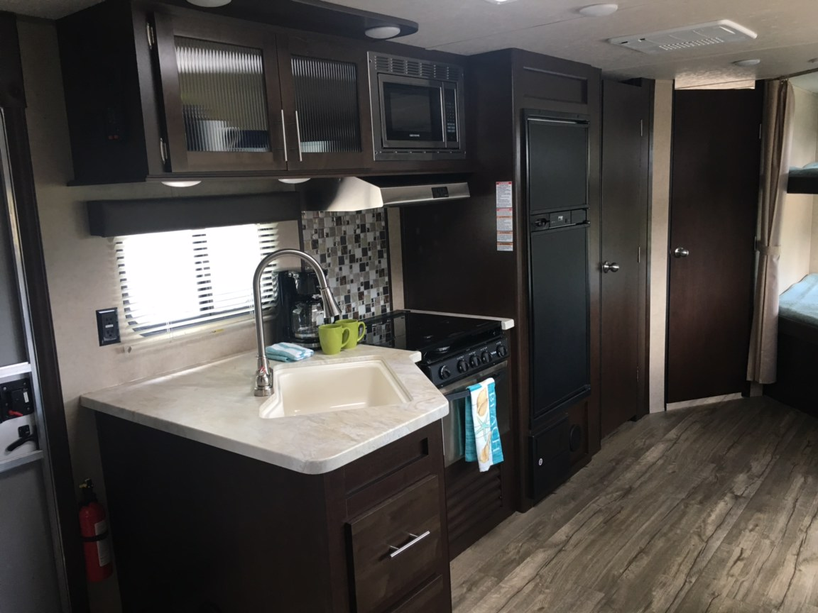 Full kitchen with pantry. Forest River Cherokee Wolf Pack 2017