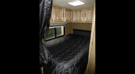 Back bed with tv and cabinets. . Coachmen Prism 2015