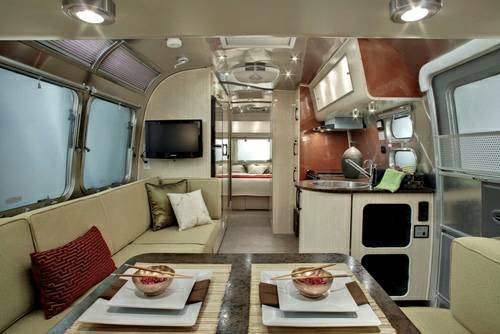 This is a promo photo, but this Serenity 27FB model is exactly as seen, with open feel, light Aspen wood tones that separate the Serenity Model for others. Serenity is a class of it's own. Rent with us, if debating buying an Airstream! Who knows, maybe we'll sell you this one! . Airstream International Serenity 27FB 2016