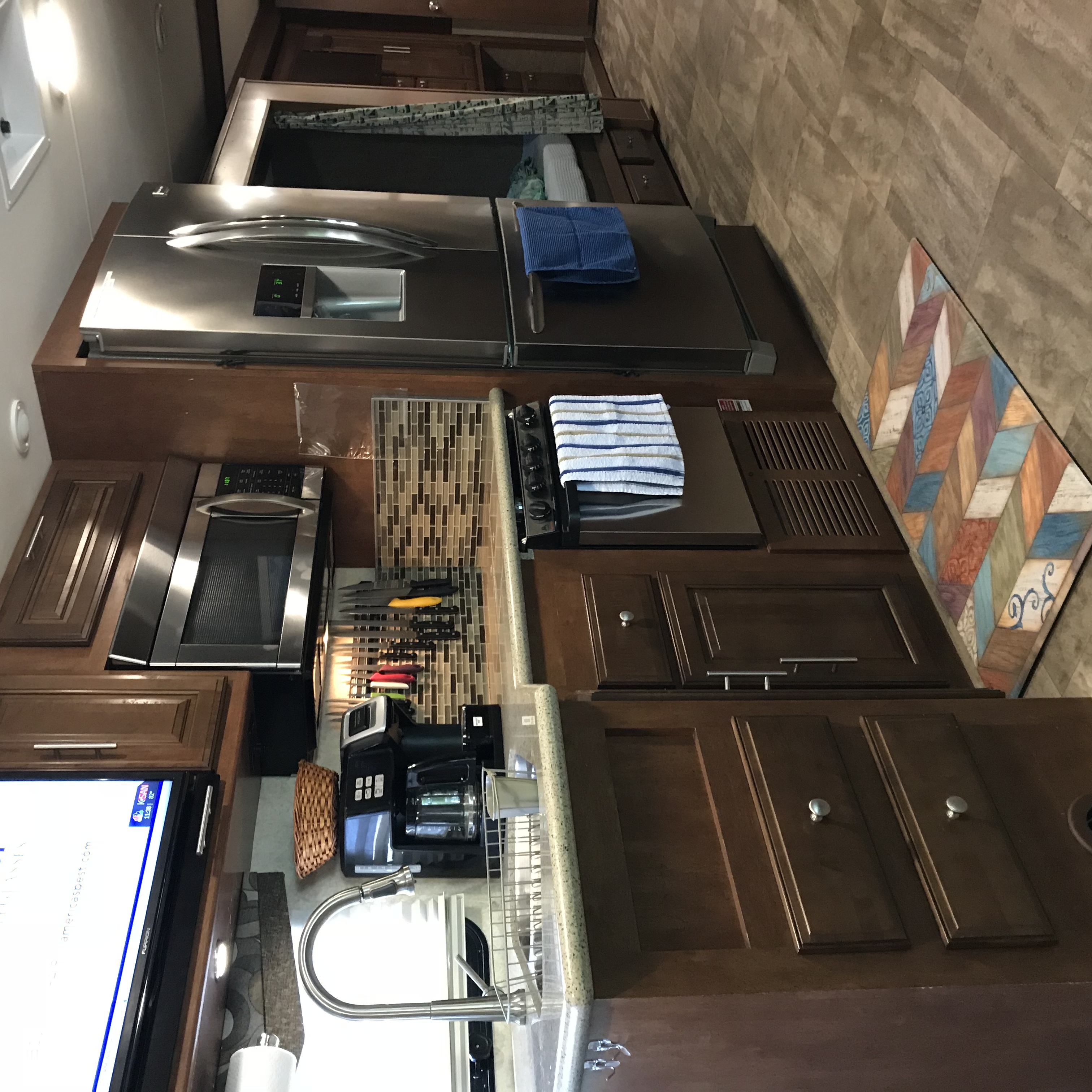 Kitchen area with all stainless steel appliances, 3-door fridge, stove, oven & microwave. Forest River Georgetown 2015