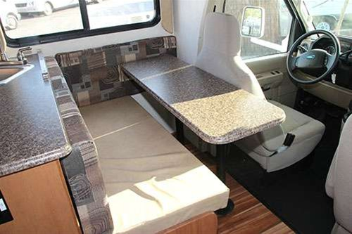 Two sets of table legs allows versatility for table or bed set up. . Coachmen Freelander 2013