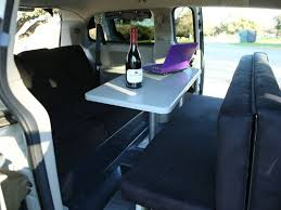 Interior shown with table & seats (4). Chrysler Town & Country 2010