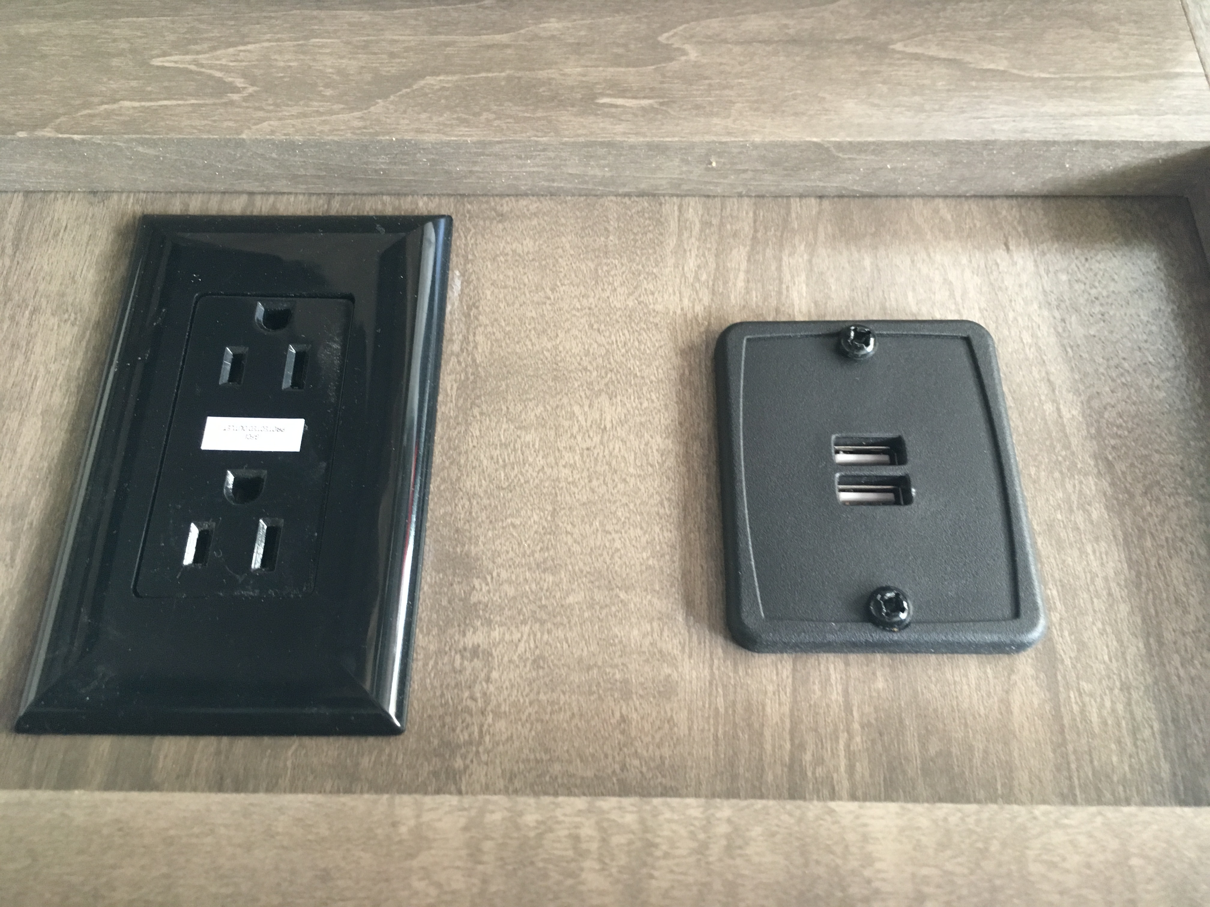 Electric outlets and there's a couple spots w/ USB ports.