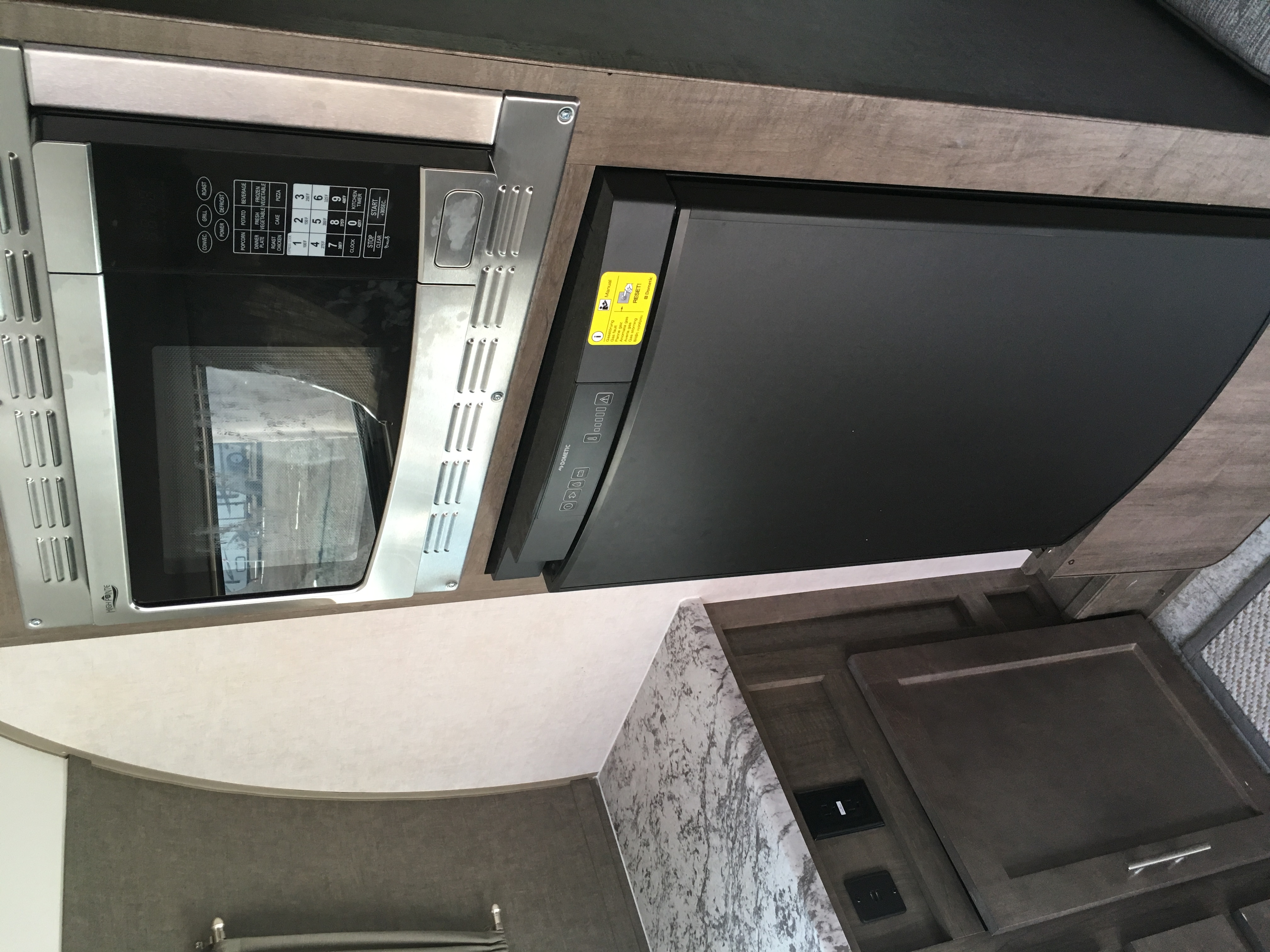 Convection microwave and fridge that runs off electric/propane/battery.