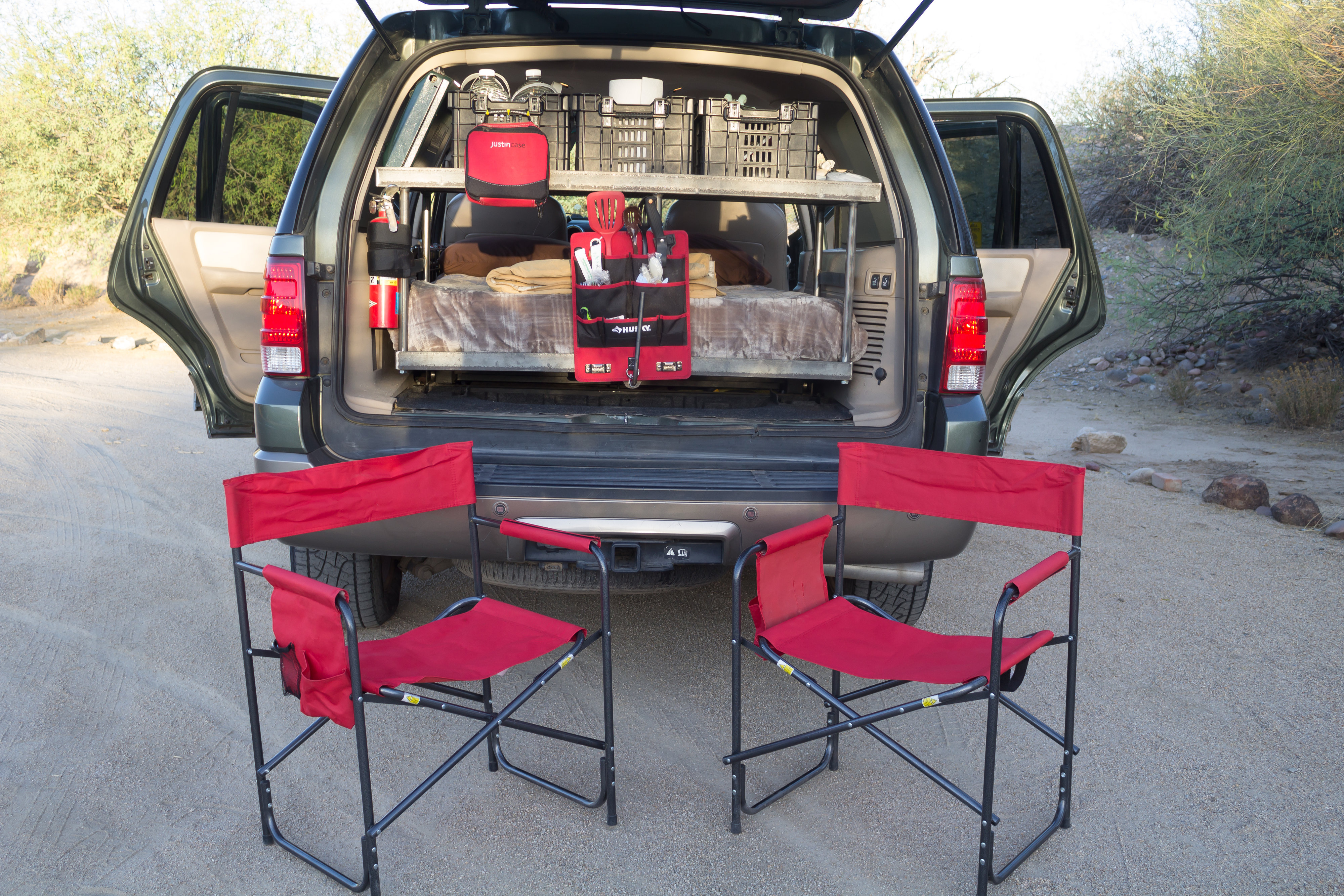 """A good shot of all our cooking gear, our chairs and table set up, and the """"everything in one place"""" concept we were going for.. Ford Expedition Camper Van Roadtrip & 4x4 Camper Van 2003"""