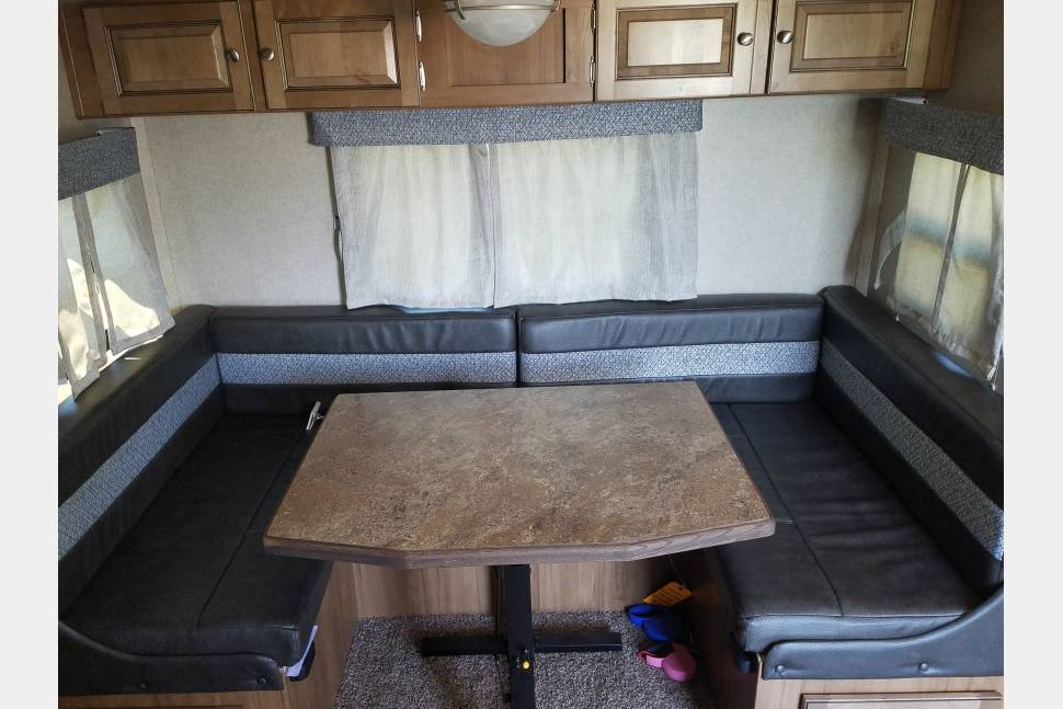 Dinette area folds down into full size bed, plenty of storage above.  . Forest River Rockwood Mini Lite 2018