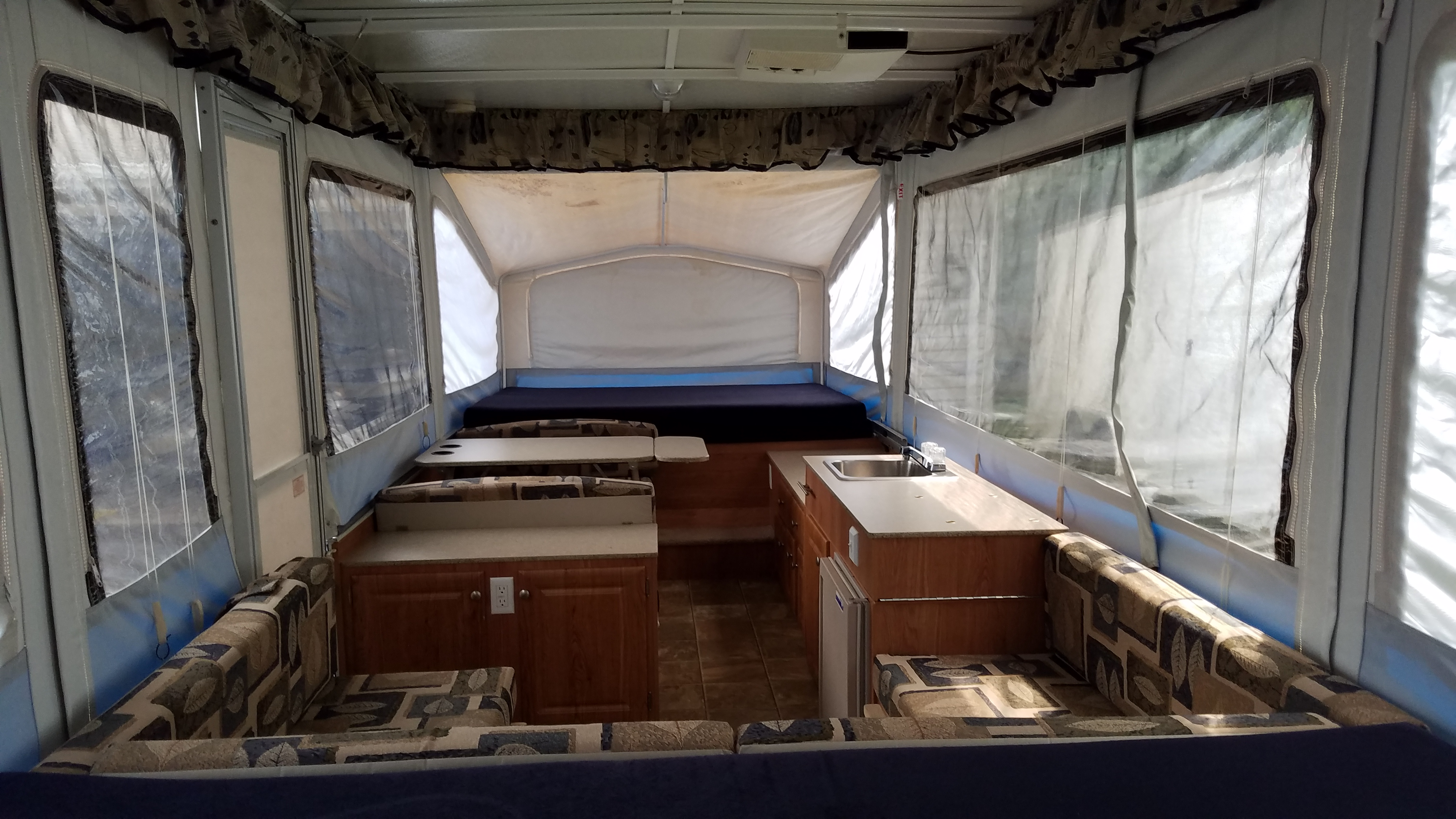 Tinted vinyl windows add privacy and shade. Curtains come down over all windows and pop out bed areas. You can get it to be pretty dark inside during the day.. Jayco Baja 2008